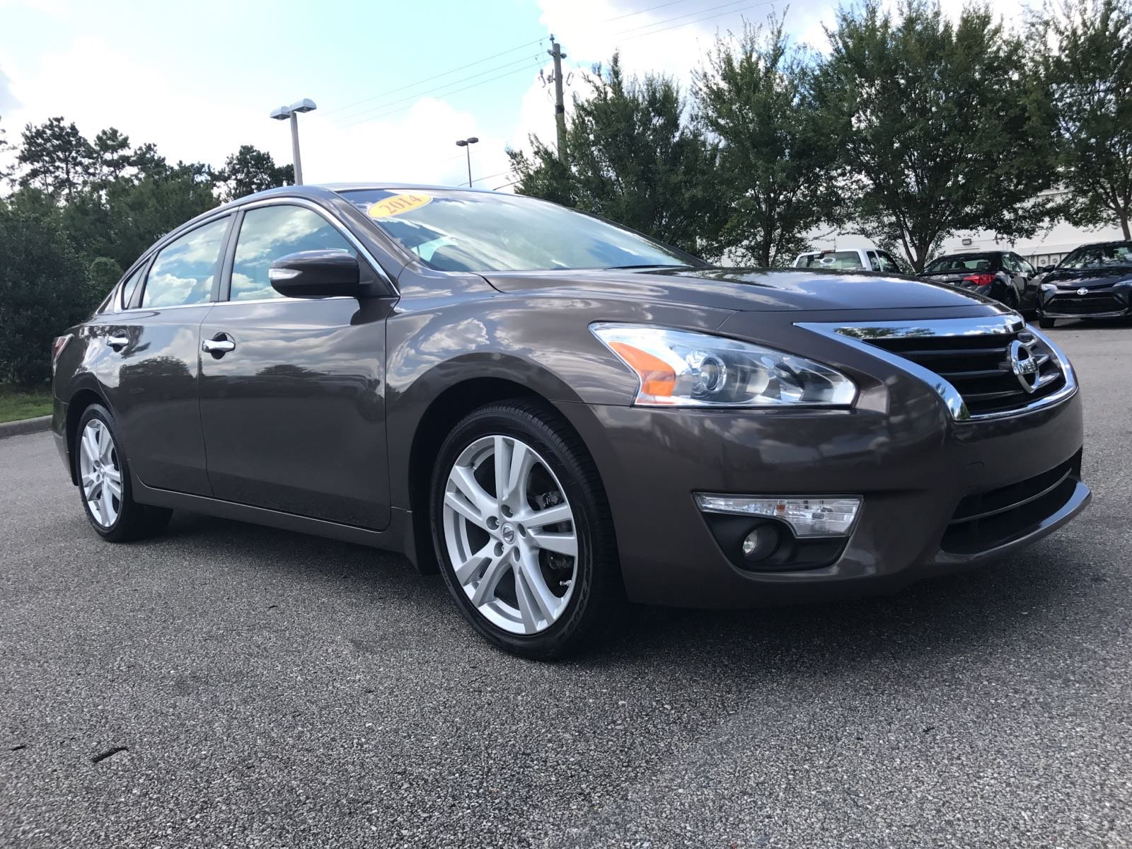 Pre owned 2014 nissan altima 35 sl 4dr car in tallahassee 13458p pre owned 2014 nissan altima 35 sl vanachro Images