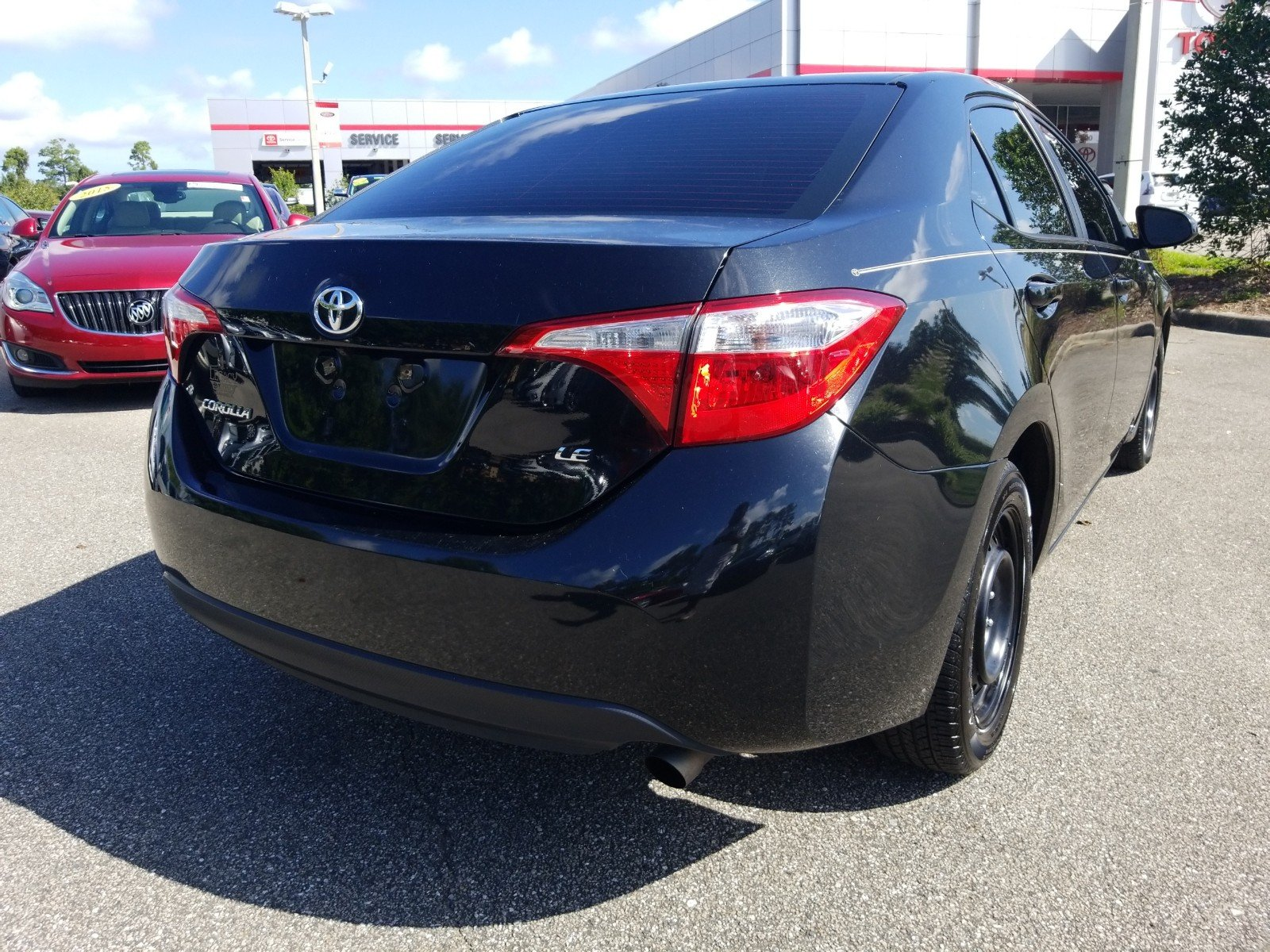 Pre Owned 2015 Toyota Corolla LE 4dr Car in Tallahassee X A