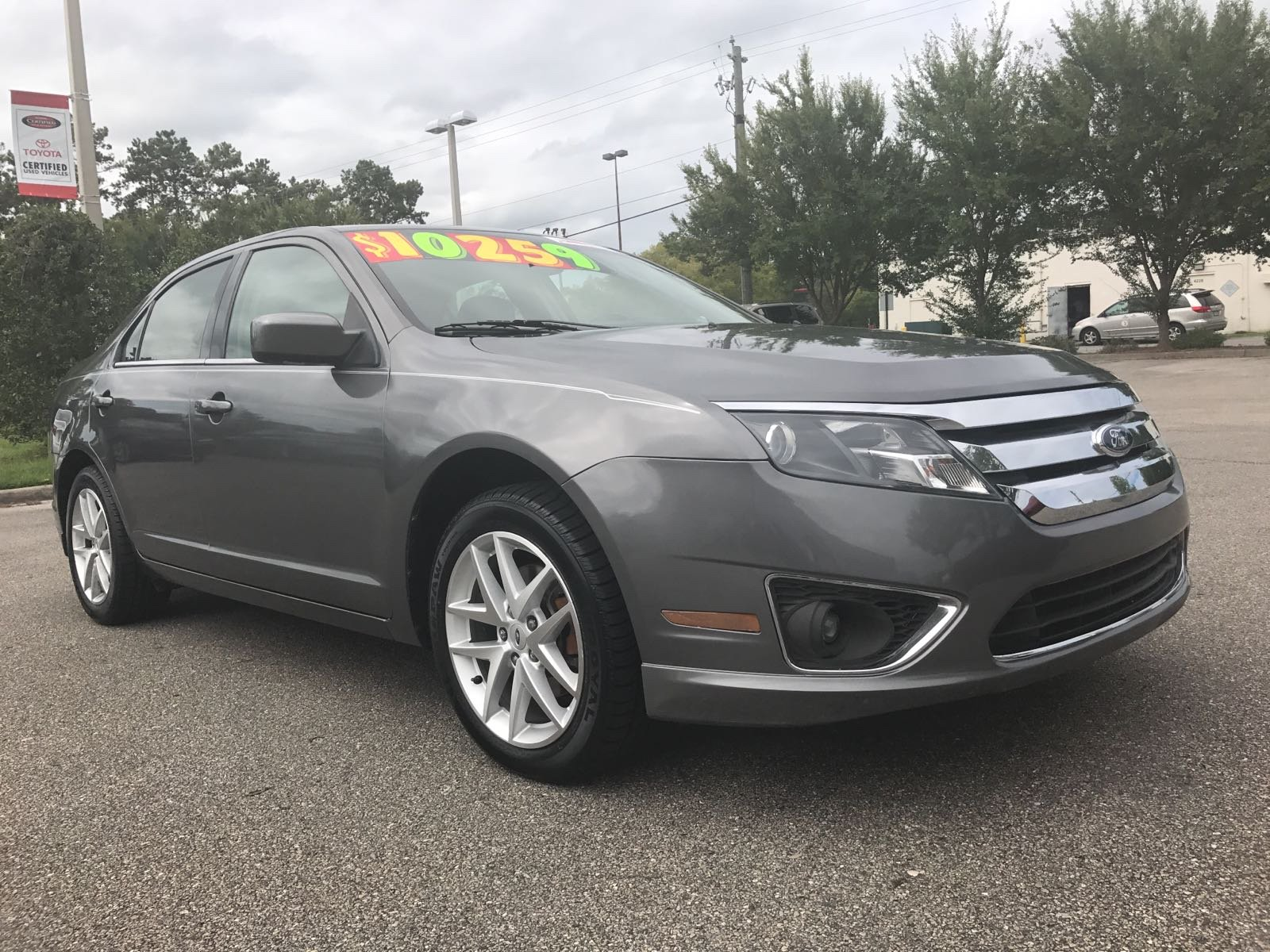 Pre owned 2011 ford fusion sel
